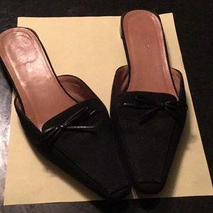 Gucci black canvas slides.